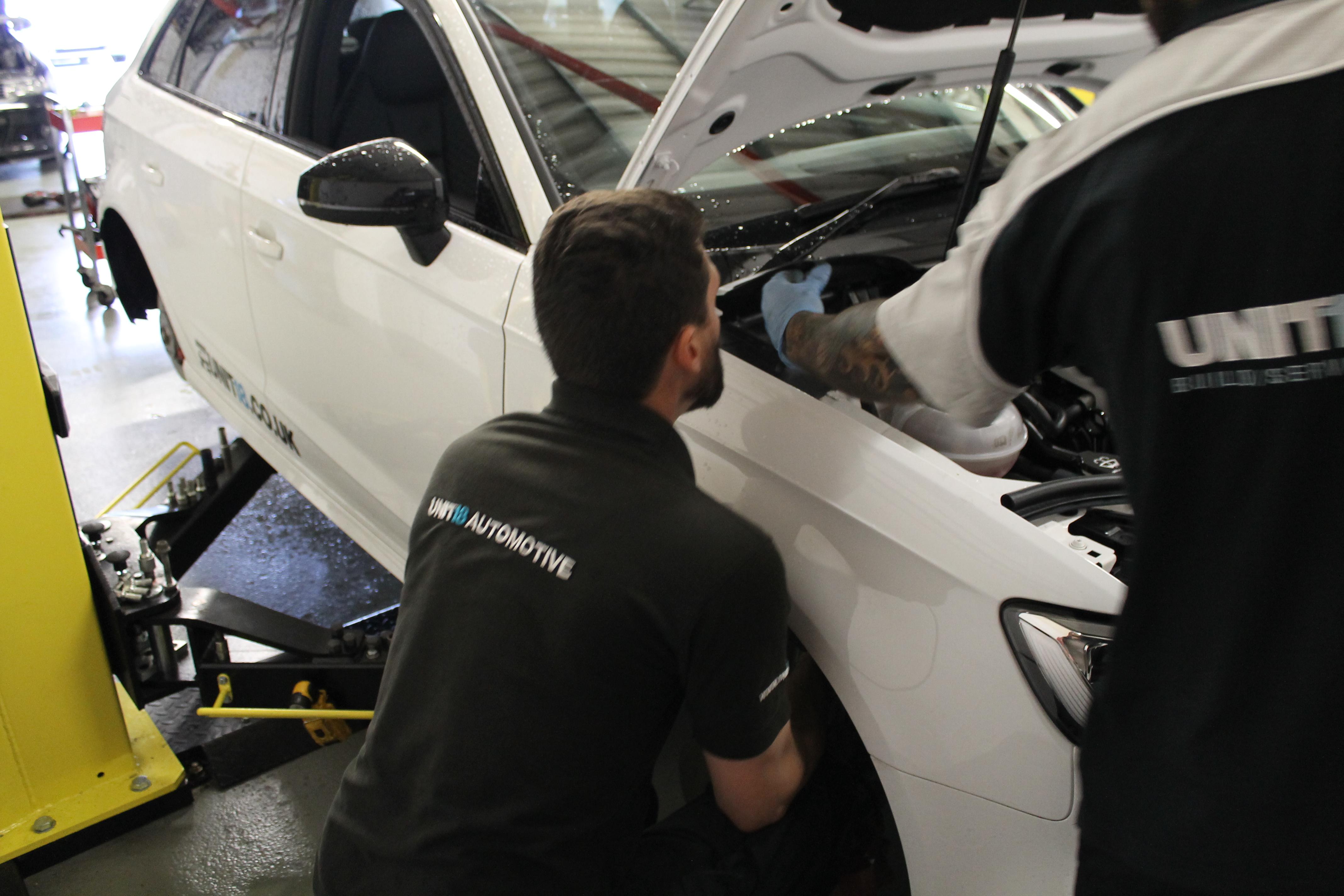 ali working on car