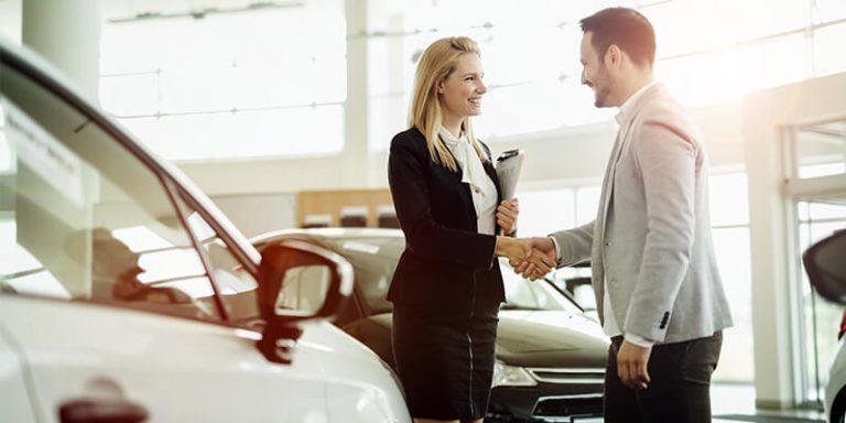 Car Saleswoman Making A Deal