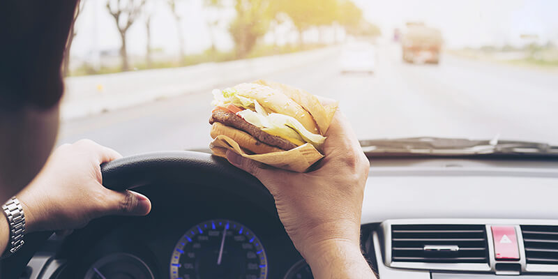 Man eating while driving