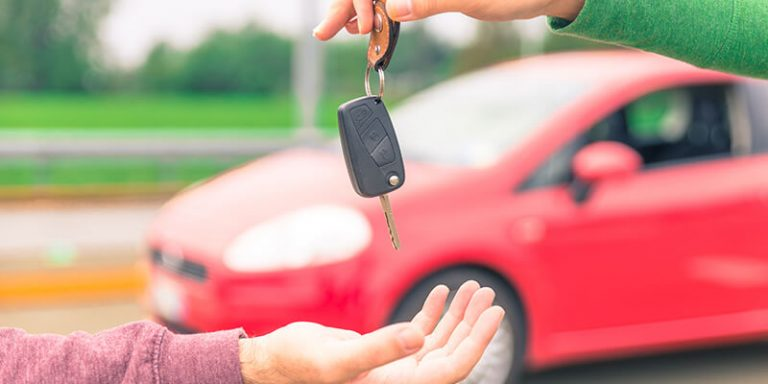 Giving car keys to new owner