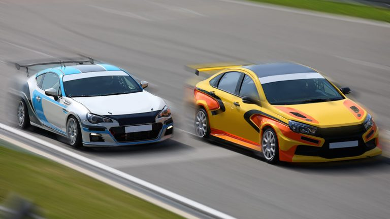 Two cars on race track